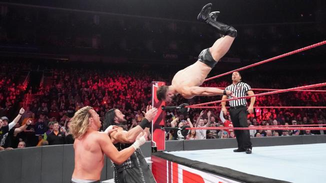 Finn Balor dives onto Drew McIntyre and Dolph Ziggler