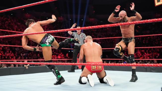 Tommaso Ciampa and Johnny Gargano give Scott Dawson the DIY finisher