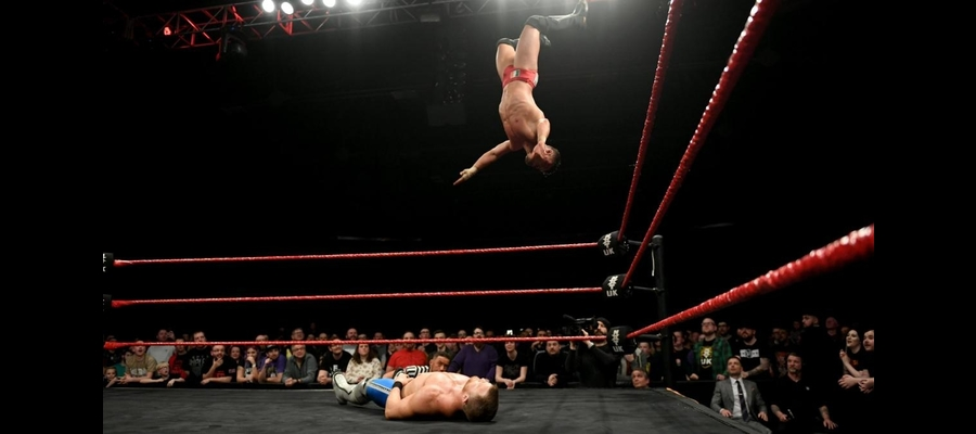 Devlin launches into the air for a Moonsault