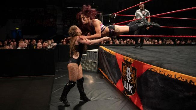 Kay Lee Ray launches herself out of the ring