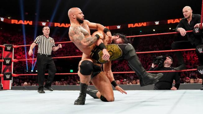 Ricochet takes a backbreaker from Drew McIntyre