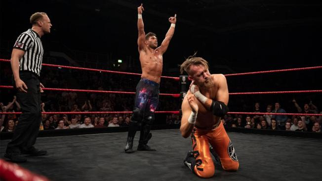 A cocky Noam Dar poses after a cheap shot