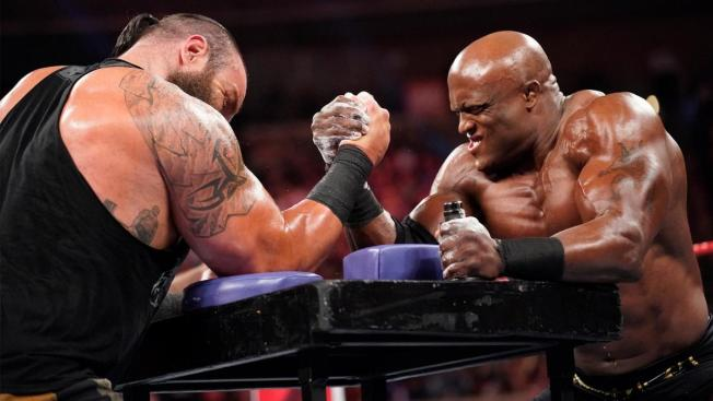 Braun Strowman and Bobby Lashley armwrestle