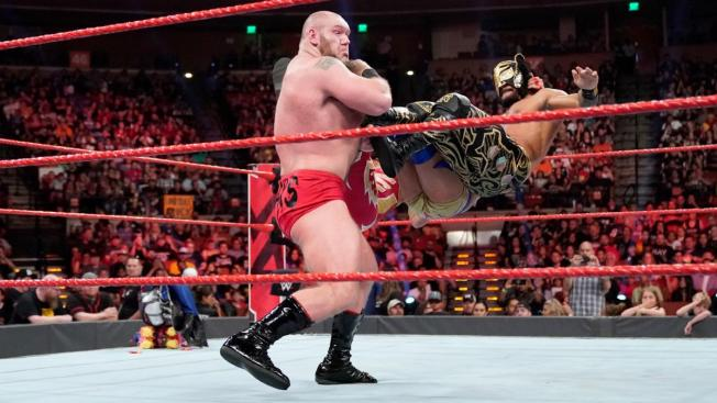 Lars Sullivan takes a triple dropkick from Lucha House Party