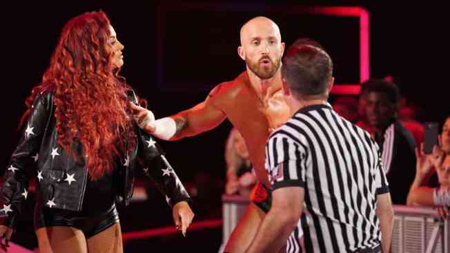 Mike and Maria Kanellis with a ref