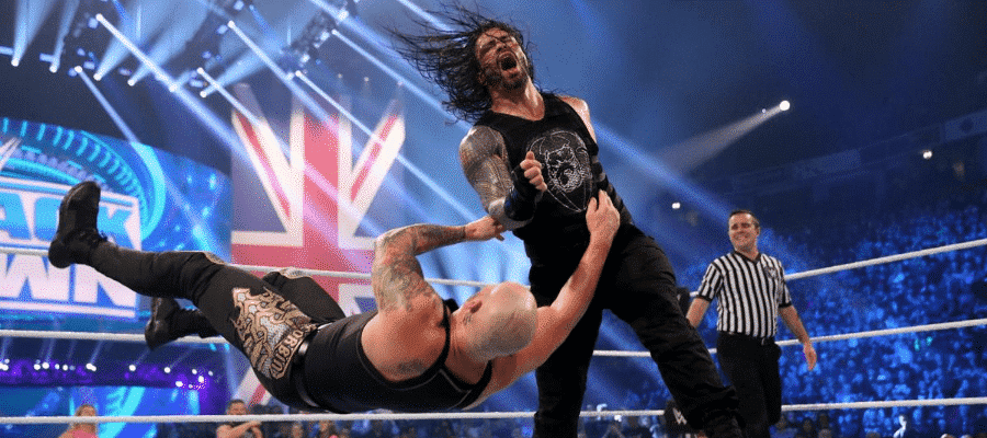 Reigns knocks Corbin to the floor
