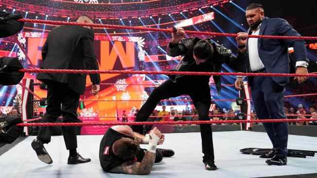 Seth Rollins and AOP beat down Kevin Owens