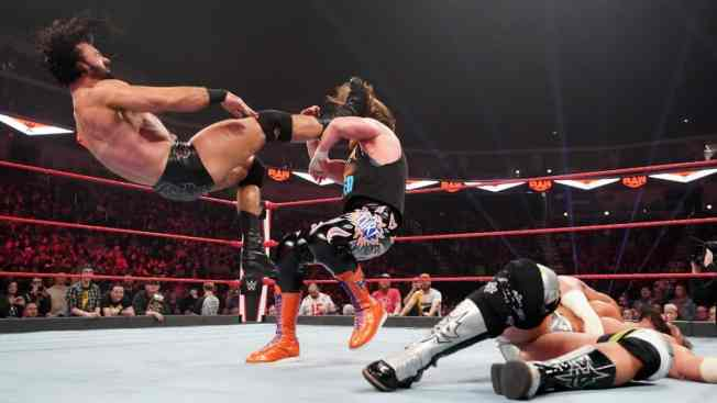 Drew McItyre gives Curt Hawkins a Claymore with Zack Ryder already down