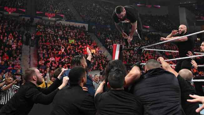Kevin Owens dives onto the mob