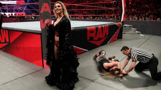 Charlotte Flair in her robe after leaving Sarah Logan Laying
