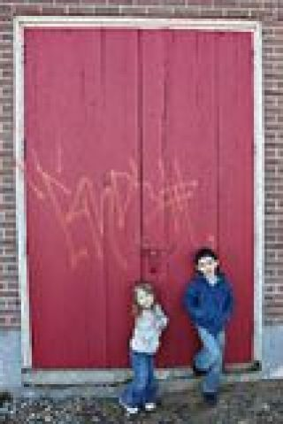 children-near-red-wooden-door-16181316