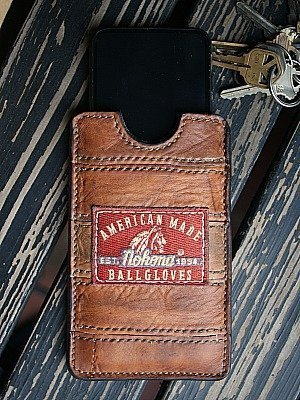 brown phone sleeve made from recycled nokona baseball glove leather