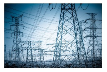 21262452 - high voltage towers with sky background. blue toned images.