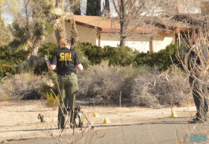 CSI processed the scene where a woman was assaulted near the house where a couple was murdered. (Christie Martin, Victor Valley News)