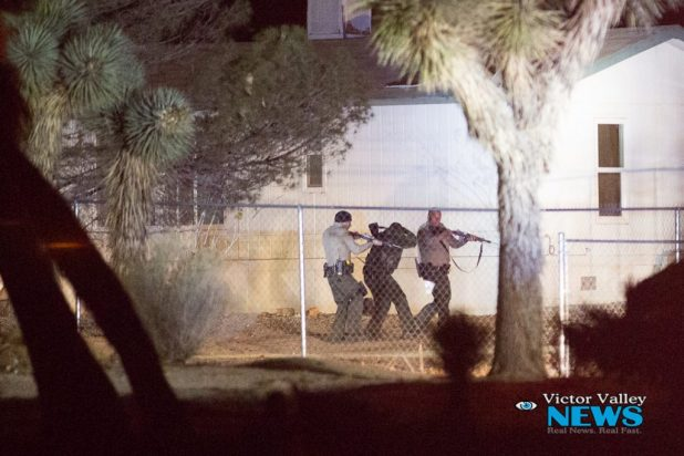 Deputies had the house surrounded for over an hour until the suspected surrendered. (Gabriel D. Espinoza, Victor Valley News)