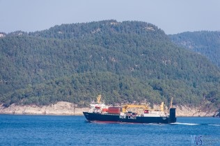There is quite a lot of shipping in the coastal waters, contrasted by hilly background of the fjords.