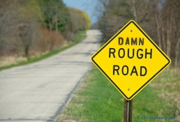 road sign, rough road