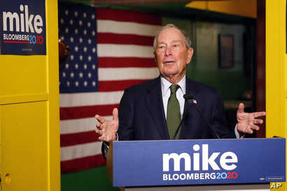 FILE - Democratic presidential candidate and billionaire Michael Bloomberg speaks to the media in Phoenix, Arizona, Nov. 26, 2019.