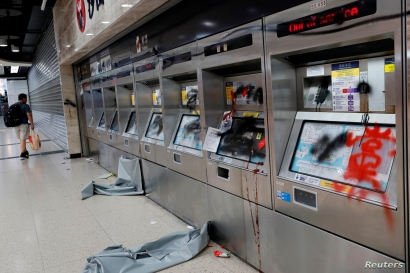 Damaged ticket machines are seen inside Sha Tin MTR station after an anti-government rally at New Town Plaza at Sha Tin, Hong Kong, Sept. 22, 2019
