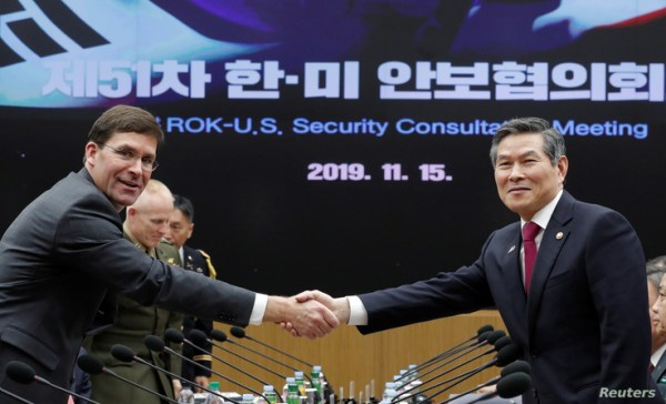 U.S. Defense Secretary Mark Esper and South Korean Defense Minister Jeong Kyeong-doo shake hands for the media prior to the…