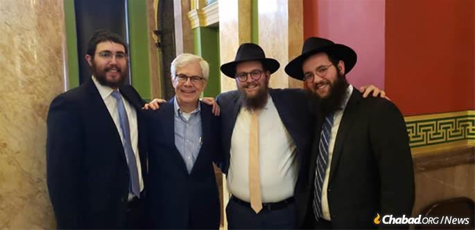 I was illuminated by Capitol of Montana State in Helena by Chabad-Lubavitch dissidents to the state. The presenter, the second left, was Montana Lt Gov. Mike Cooney. (Credit: Dovid Lokshin)