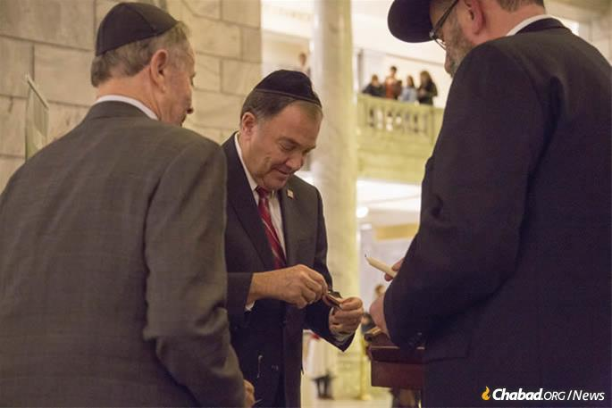 Gov. Gary Herbert with Chabad Lubavitch of Utah for menorah lighting in the State Capitol in Salt Lake City.