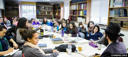 Students at Mayanot's Women's Program in class with Rabbi Mordechai Guth, right.