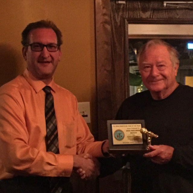 Dick Peglowski KE4SAV accepting Ham of The Year from President Keith Ainsley KG4ZXK