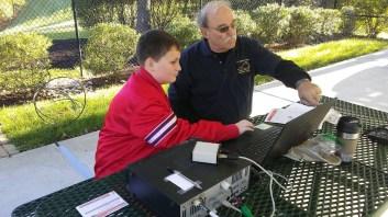 John, KG4NXT, explaining digital HF ops to a Scout