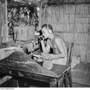 A local wireless telegraphist operator operating an AWA 3BZ teleradio at Segi Coastwatchers station, British Solomon Islands