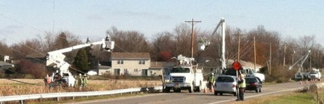 Photo of crews replacing utility poles