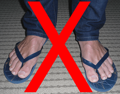 Photo of feet wearing flip-flops with red X superimposed. Flip-flops are poor footwear for severe weather days. Indiana Severe Weather Preparedness Week. #INWxReady #WRN