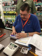 Amatuer (ham) radio operator Steve Haxby, N9MEL, helps a citizen program a weather alert radio