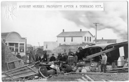 This real photo postcard shows men inspecting the damage from a 1912 tornado that hit Alta Vista. This view is identified as the August Meseke property.