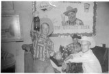 """These Flint Hills cowboys stop for a small celebration after a successful rodeo, circa 1959. Dale """"Little Red"""" Wilson, left was known to be a great storyteller, and a second, unidentified cowboy, center, and Ron Pletcher appear to be enjoying the tale. Photo courtesy Shirley Pletcher."""