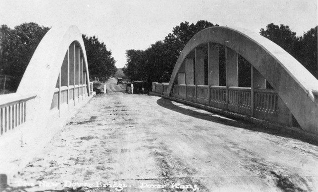 This real photo postcard view of the new concrete bridge at Dover, Kansas, looking east, was taken shortly after the bridge's completion, circa 1924. Notice the small steel bridge just beyond the new bridge. Photo Courtesy Greg Hoots.