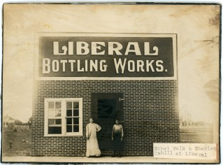 Ethel Cahill Falk and her brother, Charles Cahill pose in front of the Liberal Bottling Works in the early 1900s.