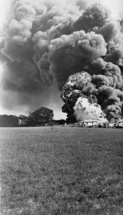 Railroad cars carrying fuel derailed and burned near the Volland depot in this view, dated 1920.