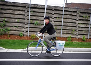 Riding my bike at the official opening of Martin Luther King, Jr. Way in Spokane. The city's official plans for the opening didn't involve bikes but when I started rolling and headed past the police officers who were there, no one challenged me. That's privilege.