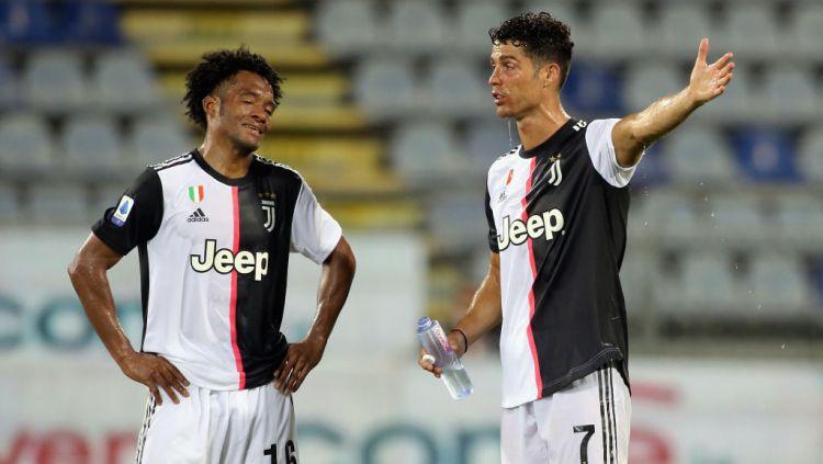 Juan Cuadrado dan Cristiano Ronaldo tampak kelelahan melawan Cagliari