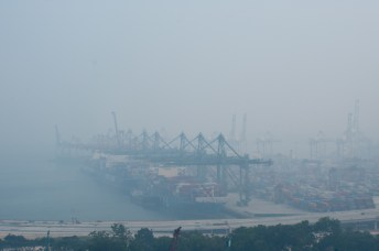 Singapore harbor disappearing in the haze