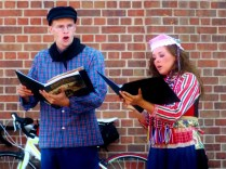 Singing Traditional Dutch Songs? (I see your LOTR book!) Pella, IA, RAGBRAI 2013, Copyright Robert Hartwig.