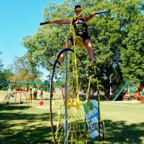 Climbing the giant Penny Farthing, in route to Fort Madison, IA. RAGBRAI 2013, Copyright Robert Hartwig.