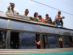 passengers on top of a bus