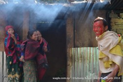 A man and women in Khabang Bagar shared a laugh after the man got his face smeared in colored powder by a girl (not seen in the photo)