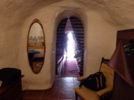 In Master Bedroom looking through dining room to entry hall and front door. (Deep in the cave.)