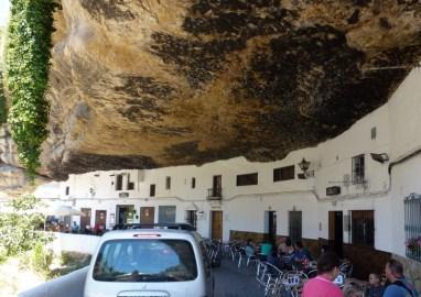 Cafe - Road under rocks