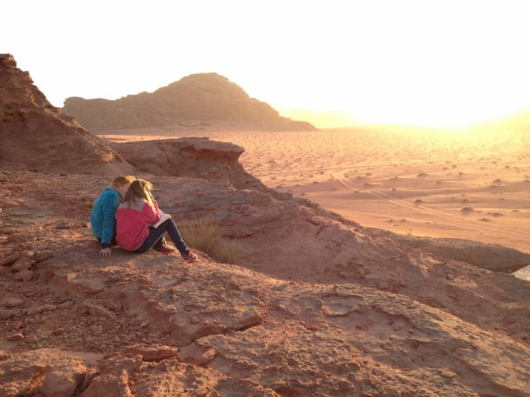 Calla and Magno find a good spot to watch the sunset in Wadi Rum, Jordan.
