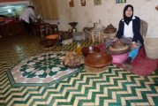 Grinding Almonds to make cosmetics and cooking supplies in Marrakech Medina