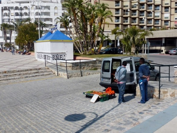 Produce man in front of Chinasol along San Cristobal Beach